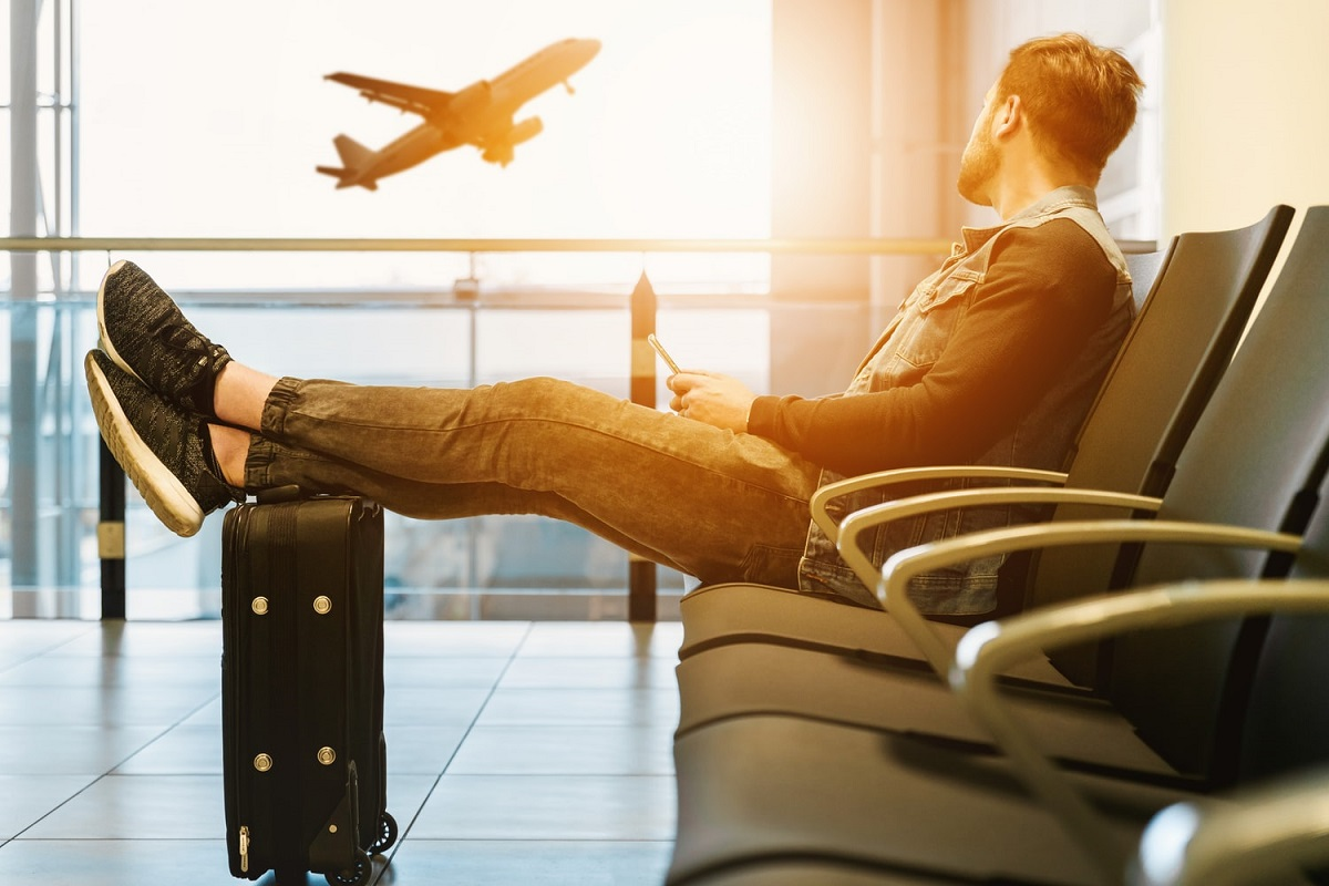 Man is waiting for plane in airport