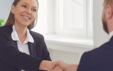 A woman handshaking