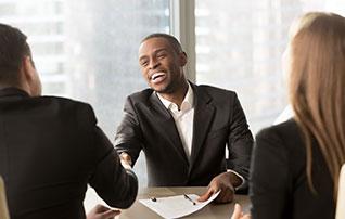 Black man handshaking and smiling